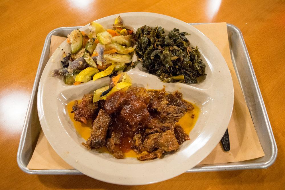 My plate: chopped brisket, roasted veggies, and collard greens
