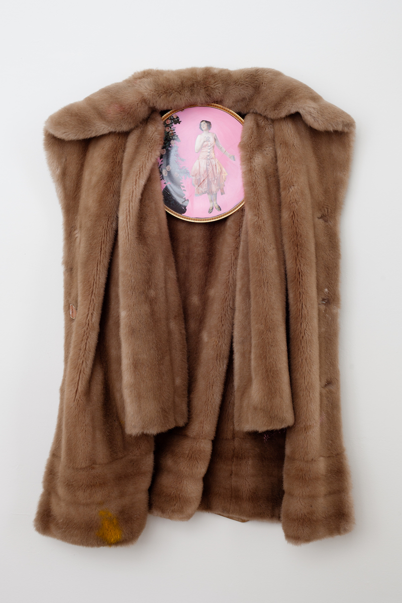 "heather garland // standing in the doorway // 2016 // oil and on found ceramic plate with faux fur coat // 33"" x 21"" x 5"""
