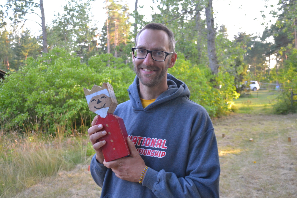 Kubb Farmer - Aaron Ellringer - Holding what is thought to be the first King of the modern Kubb Revolution in Gotland, Sweden.