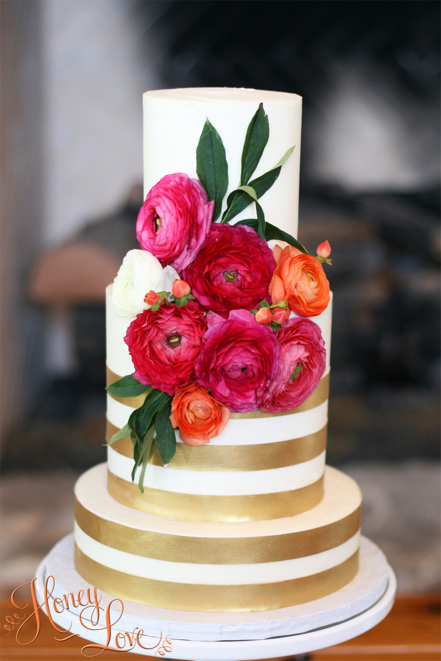 "This buttercream wedding cake has one 8"" layer on the bottom and three layers in the 6"" and 4"" tiers."