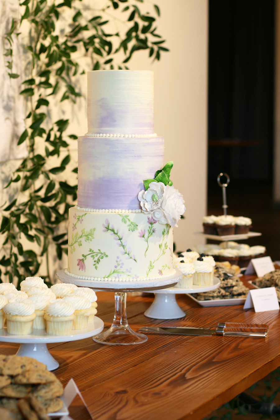 Hand-painted buttercream on the bottom tier, this whimsical beauty was the centerpiece of a fabulous dessert table.