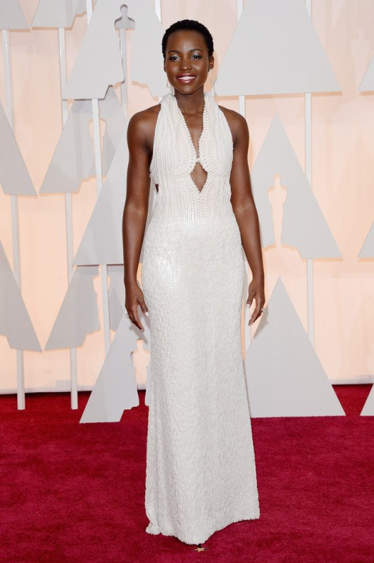Lupita Nyong'o beamed, looking like an elegant pearl of the sea. The best part of this look was Lupita's toned arms and glowing skin.