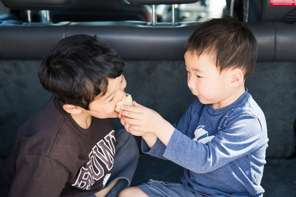 Sharing treats at a roadside ice cream stand.