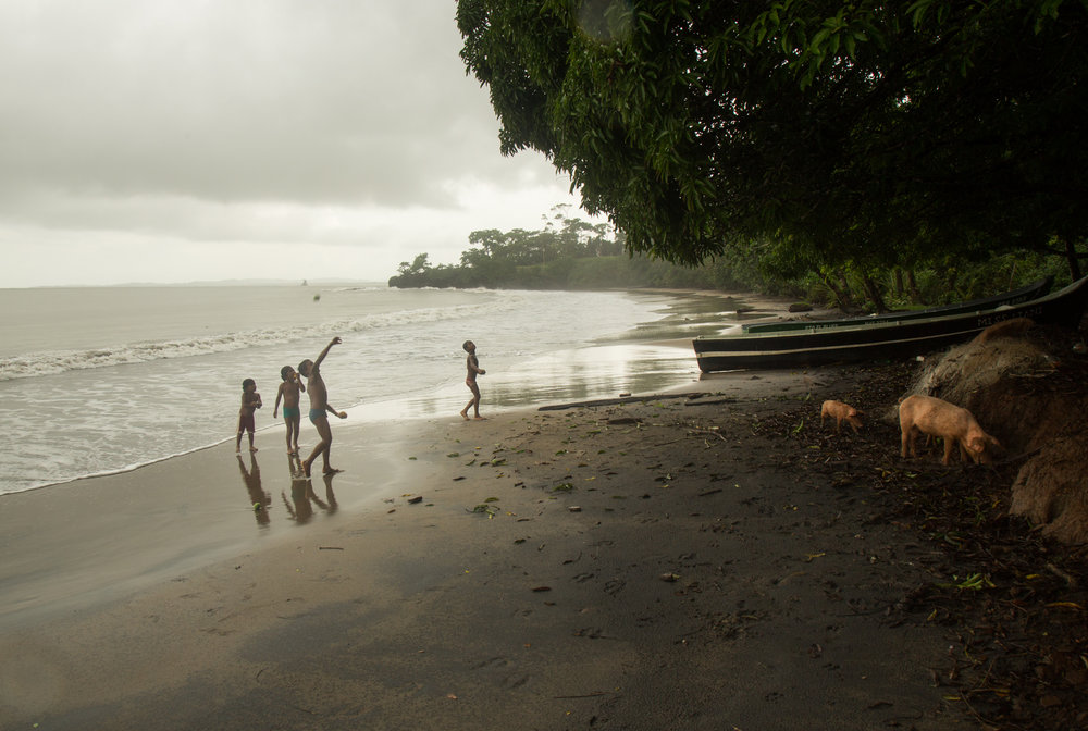 Children of the indigenous Rama community of Bankukuk, on Nicaragua's southeastern Caribbean coast play on the beach on June 18, 2016