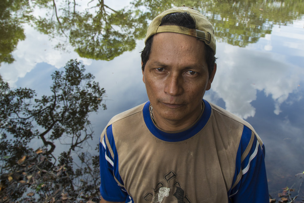Azdrubal Linares Vaca, a local farmer, facing the only freshwater lagoon on his property he says that has not been contaminated by oil. An oil spill in the Caño Rubiales in 2013 contaminated 5 of its 6 lagoons and killed all his animals, also polluting his family's water source. St. Helena, Meta, Colombia. April 10, 2017