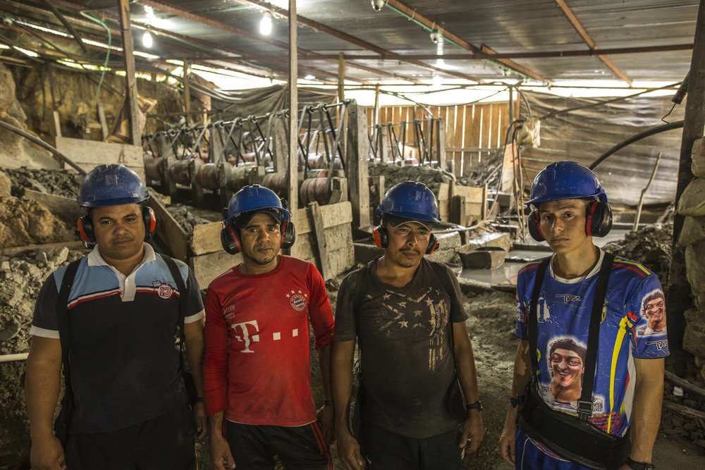 Evan Manuel Sepa Anguilla, 24, William Moreno, 37, Luis Miguel Gil, 39 and Servant Four, 29 work mechanized, spinning barrels to separate the mud of the mountain in a process to extract gold. They are members of the ASOMIWA cooperative which is being threatened by a private mining company that wants to sell the land to a transnational corporation. South Bolivar, Colombia. May 12, 2017