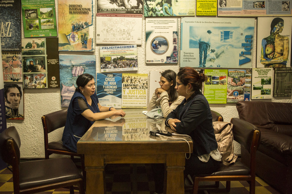 Julia Figueroa, human rights lawyer and leader of the CCALP, all women's legal collective, meets with two young lawyers from the region who she is recruiting into her cooperative in the office during the evening in Bucaramanga, Colombia. May 9, 2017.