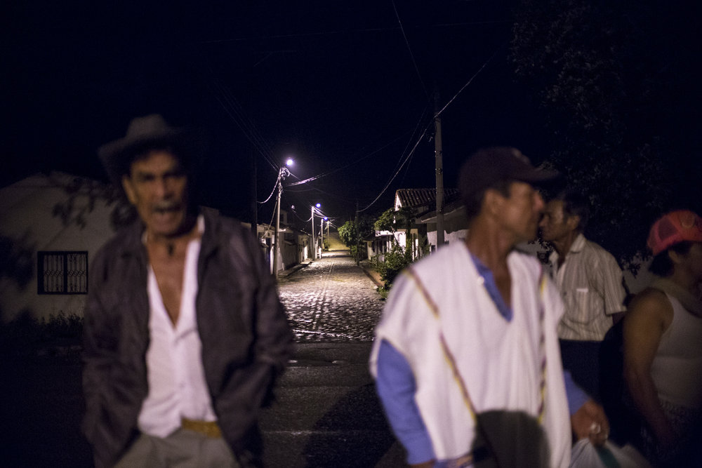 Members of ASOQUIMBO return to their hometown at 3am after a ceremonious homecoming for their battle against the Italian transnational company ENEL which constructed the Quimbo dam on the Magdalena River, displacing some 30,000 farmers and fishermen and disrupting a productive agricultural region. Neiva, Huila, Colombia. 18 de marzo, 2017