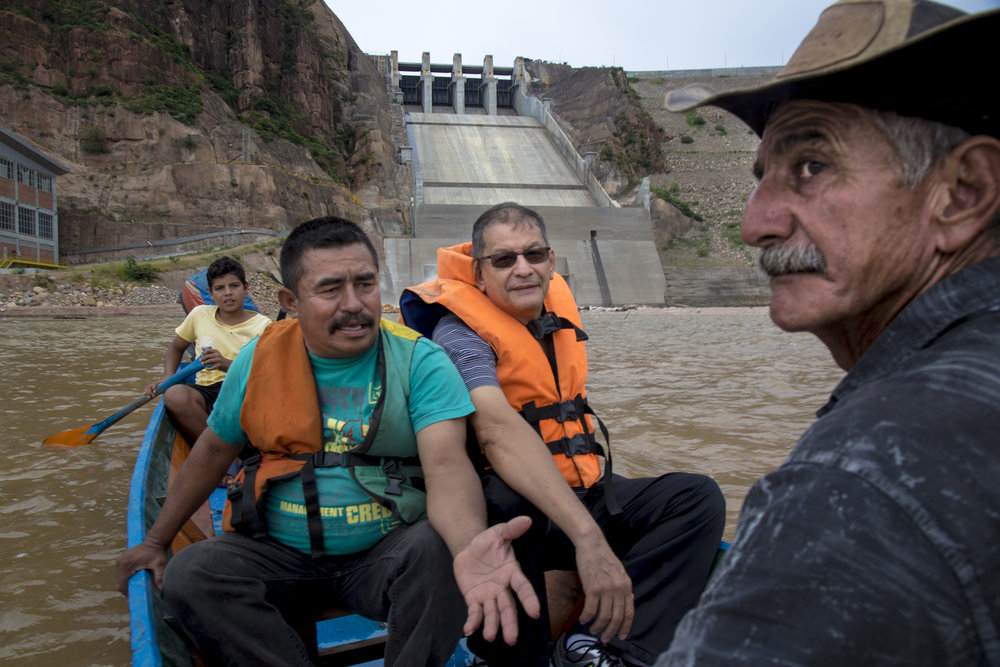 Miller Dussan (second from right), professor and leader of ASOQUIMBO rides up to the base of the Quimbo dam with local fishermen who have been part of the resistance to the construction of dams along the Magdalena river. Neiva, Huila, Colombia.