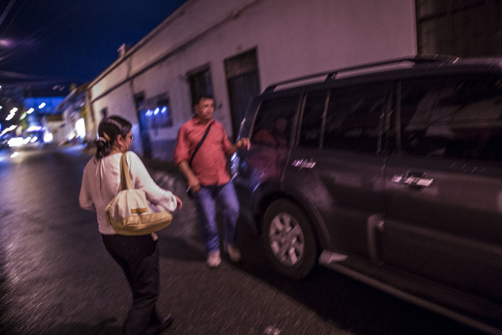 Julia Figueroa, human rights lawyer and leader of the CCALP, all women's legal collective, walks to her state provided bullet proof SUV with her bodyguard after a syndicate meeting in Bucaramanga, Colombia. May 8, 2017.