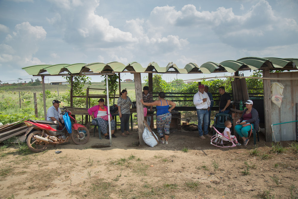 Héctor Sánchez spends time with frinds in his community during a mall barbeque on a Sunday afternoon. Rubiales, Meta, Colombia. April 9, 2017