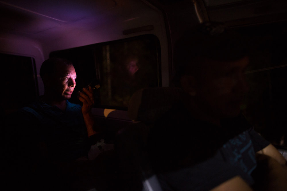 Angel Custodio Luque, one of the leaders of ASOMIWA who has been threatened by paramilitaries, ELN and the Colombian state for his work with the cooperative, in a van returning to Santa Rosa at night. Mina Walter, South Bolivar, Colombia. May 12, 2017