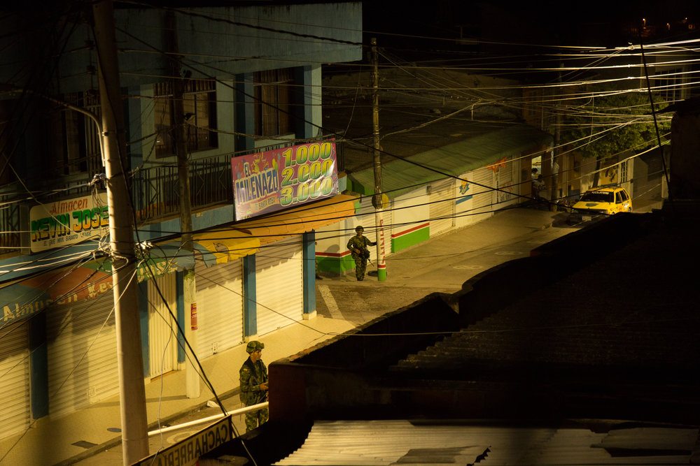 Soldiers on an early morning patrol in the town of Santa Rosa where the Colombian state had never had a real presence before the new peace accords.  Bolivar, Colombia May 13, 2017.