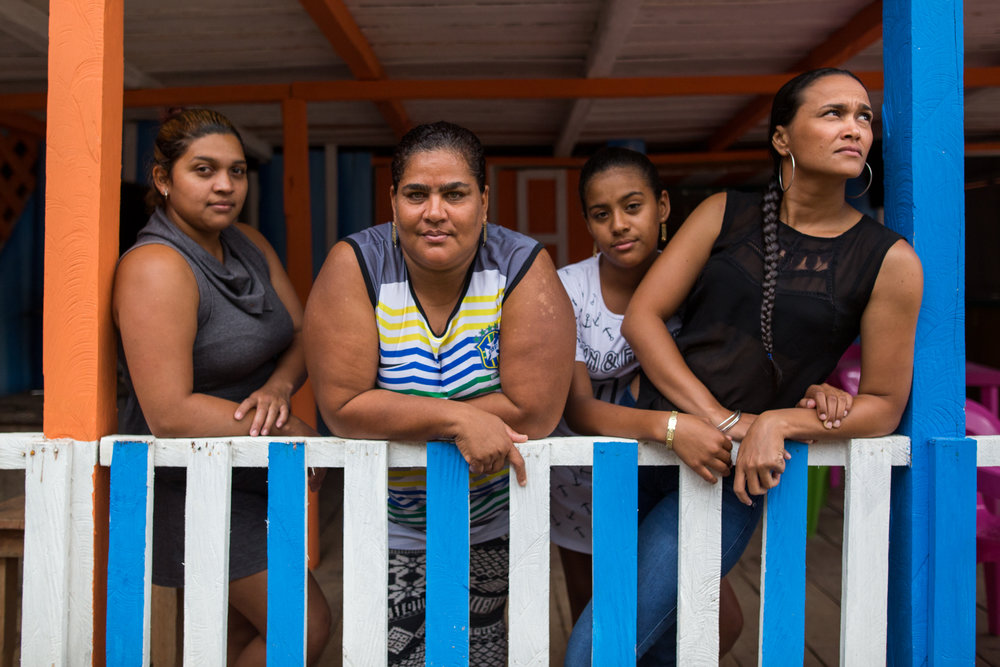 Marisol Cueto, 42 (second from left), with her nieces Mayerly, 24, Yessica, 12 and Viviana, 32 in her restaurant. Marisol was one of the founders of Mina Walter 15 years ago and is now concerned that her family and business may be displaced by economic interests in the mine by a private company. Mina Walter, Sur Bolivar, Colombia May 12, 2017