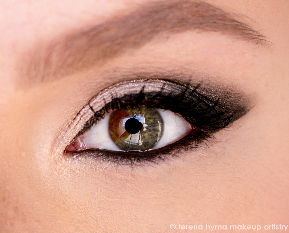 Close up of smokey winged eye liner