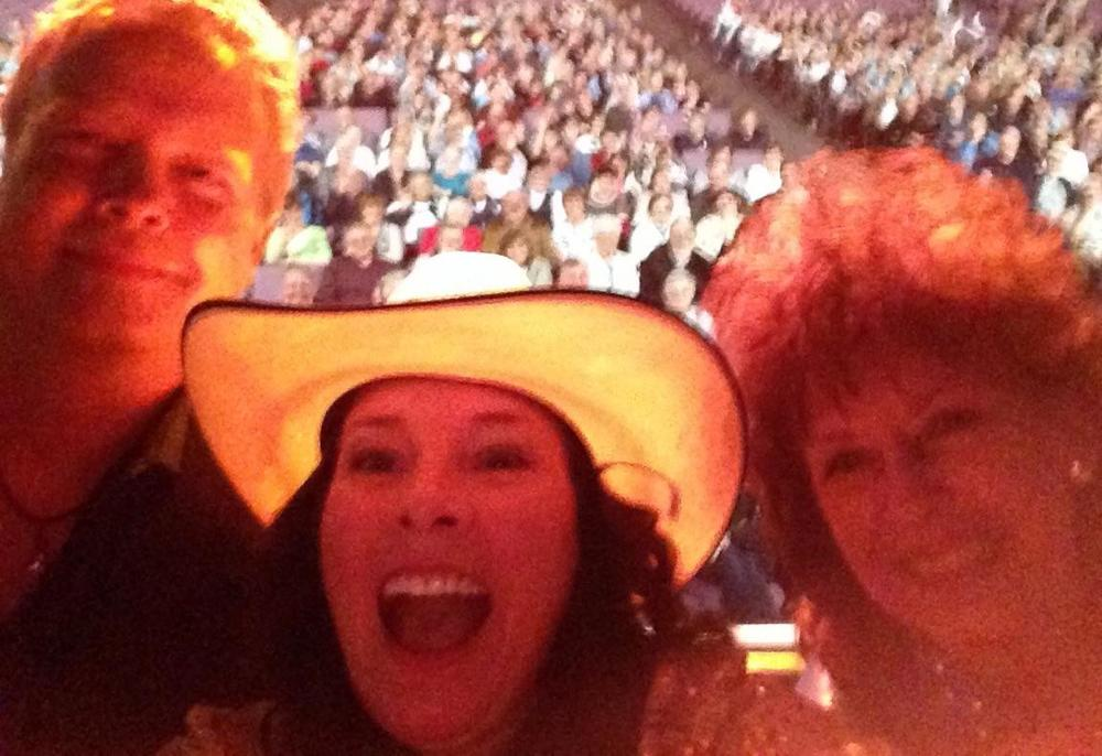 "Ron Williams, Maggie Mae, and Leona Williams at the Crystal Grand in May of 2014 ( taken from stage for a ""Selfie"" )"