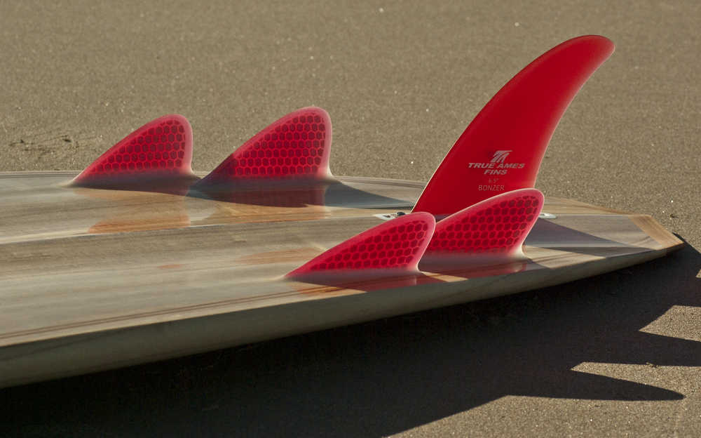 Red Fins on a Bonzer Hollow Wooden Surfboard