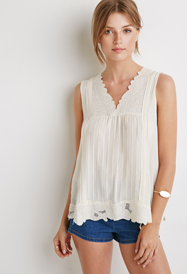 Pleated Floral-Embroidery Top, $22.90   I've been really into whites lately, and this one is so cute and light.  The embroidery adds some pretty details, and could be dressed up or down.