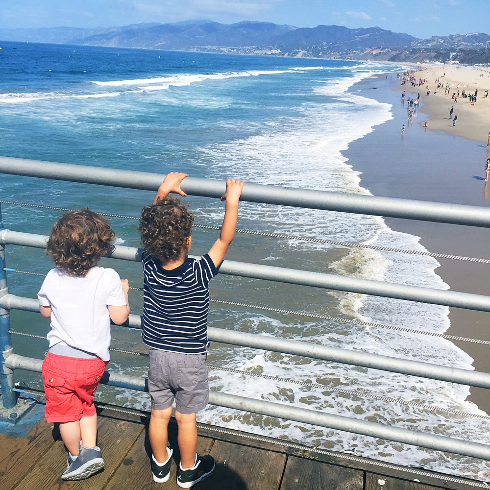 Last time we came to the pier, my son was afraid of the waves. This time he was showing them off (mine's the one in stripes.)