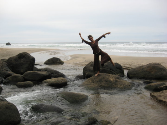 Deb dancing on the beach