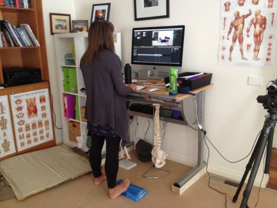 Mel's Standing Desk - please note the 1/2 dome strategically placed. Here I can pelvic list, toe stretch, reach and release, thoracic stretch - do my arm and neck releases, and the list goes on.