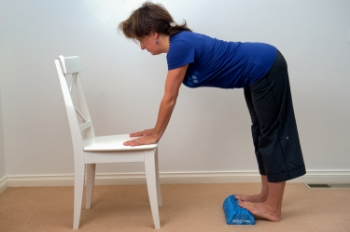 Double Calf Stretch: We did this in class last week and people loved it so much we'll do it again next week too. It you ever watched Spinal Tap, this turns the Calf Stretch up to 11. That's right, it's that good! Lean forward and let your palms rest on the seat of a chair (or a bench or desk or .... you name it). Moving one foot at a time, step up onto the half dome with both feet. Keep the heels on the floor. Make sure your feet are straight ahead and relax your back, gently lifting your tailbone to the ceiling to increase the stretch down the backs of your legs.