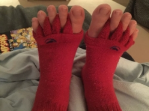Here is an anonymous entry of some toe socks and their owner getting ready for bed. Is that a Simpsons comic I spy? No judgements, I love the Simpsons!