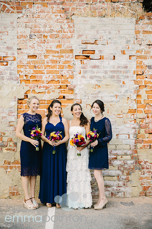 Bride with bridesmaids on Fremantle Brick Wall