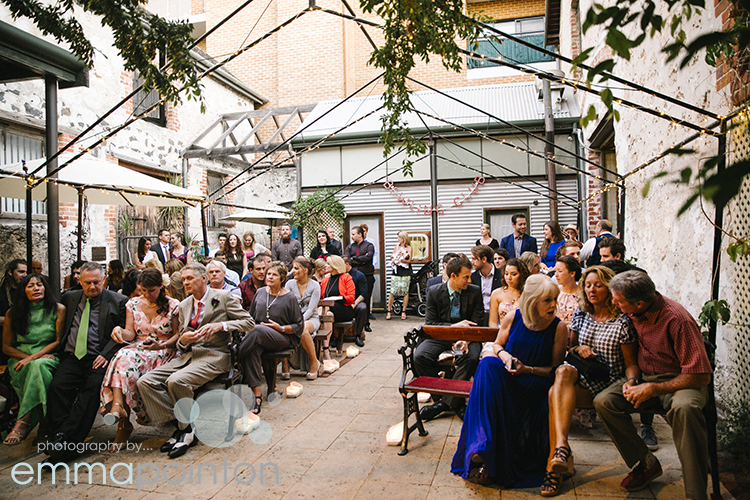 Wedding guests in Moore & moore courtyard