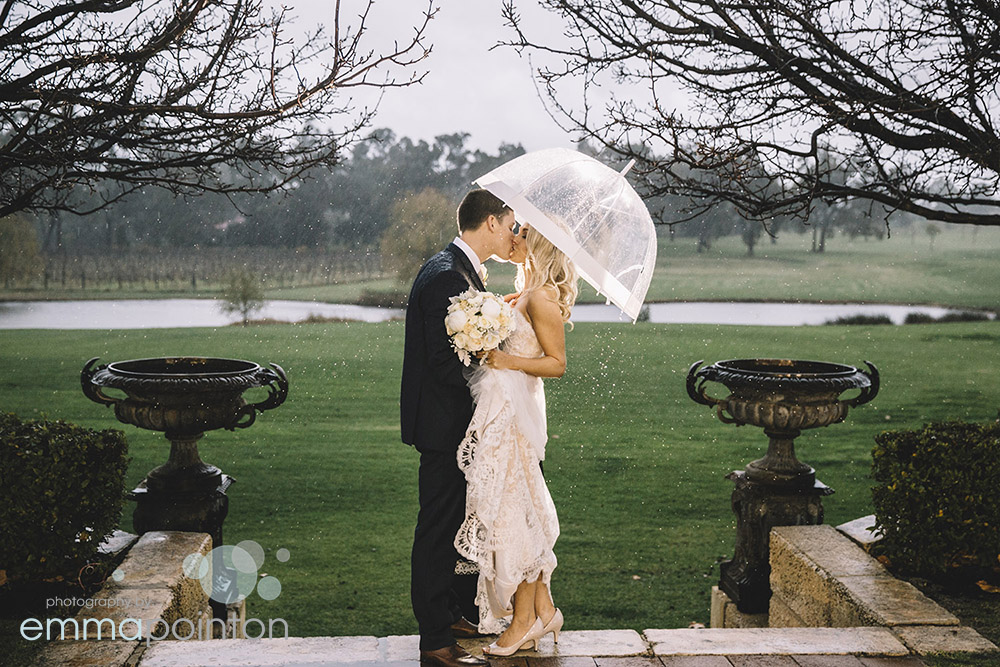 Emily & Tate, embracing the rain on their wedding day!