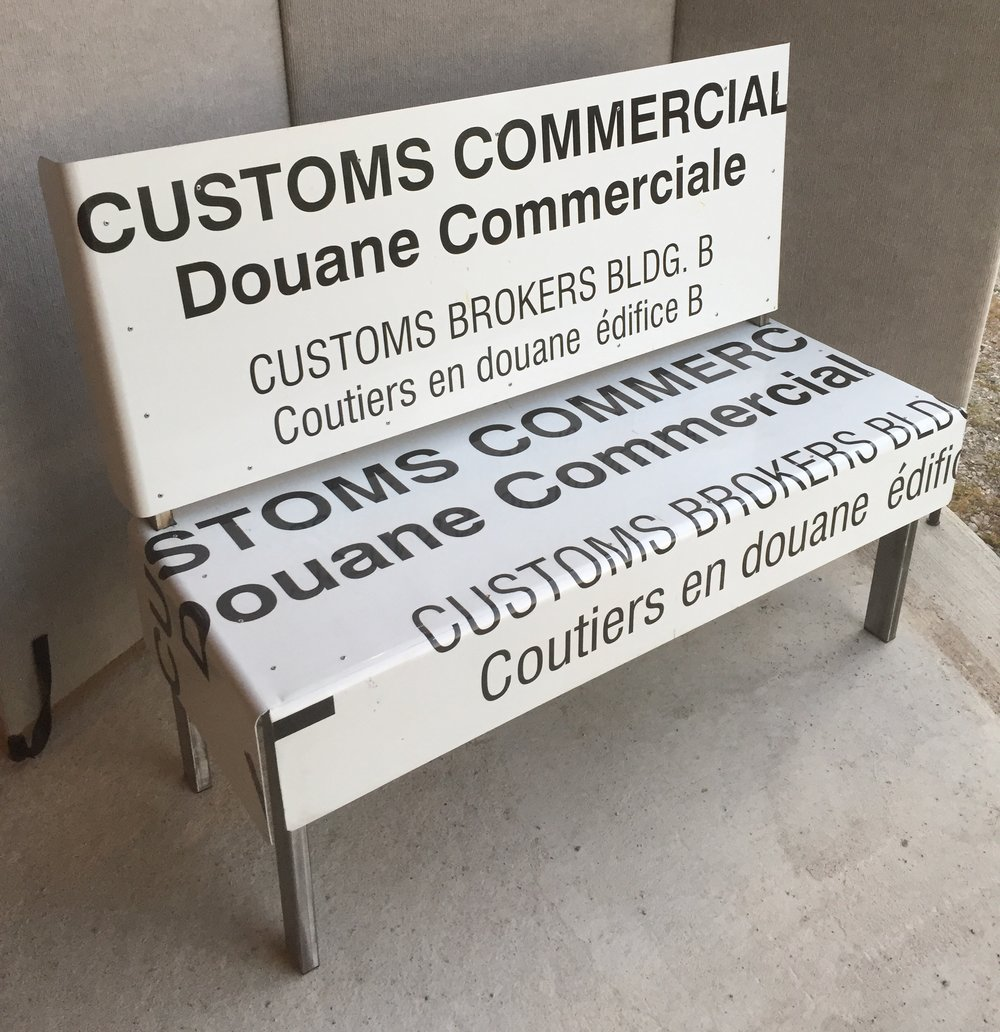 "Large decommisioned signs from Canadian Border Crossing made into a unique bench.  42"" across. $900"