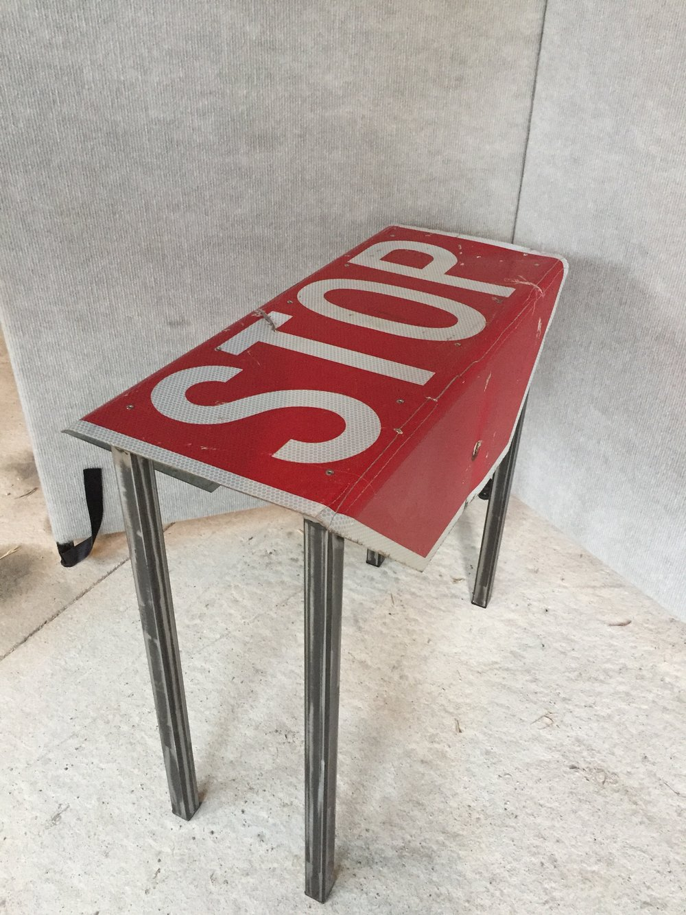 Decommissioned Stop Sign makes a great end table.  $250