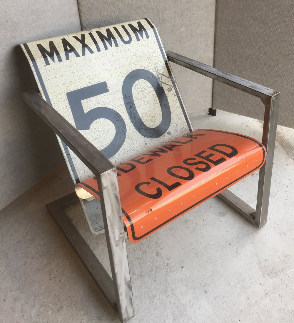 This Muskoka style chair made from road signs is surprisingly comfortable.  $800
