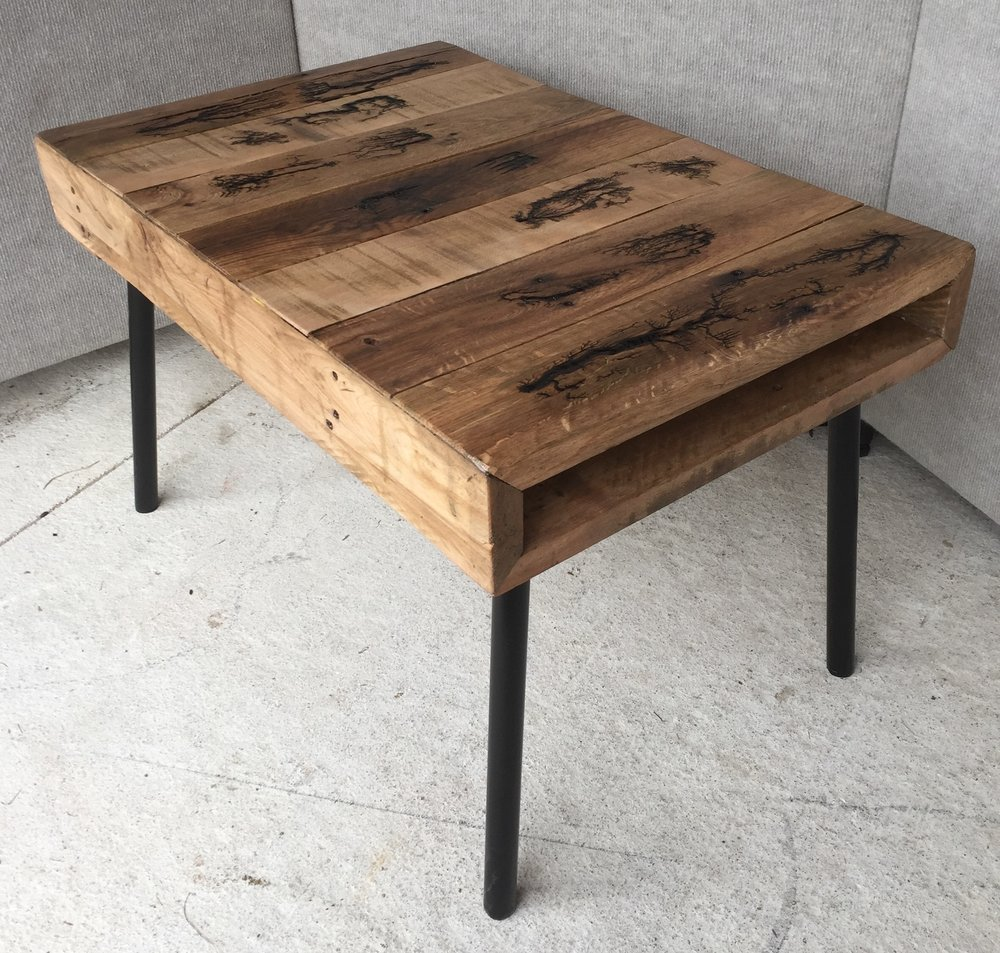 Hardwood pallet coffee table with electro-burning