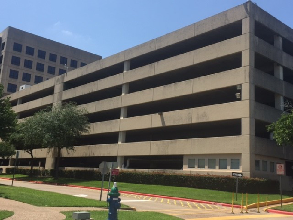 The Woodlands Parking Garage Cleaning - Before Pic - Notice the widespread grime covering, literally discoloring this entire side of the Houston parking garage structure.   Standing dirt like makes a garage structure look ten years older.
