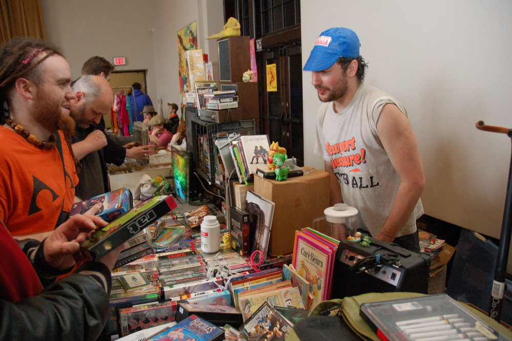 Above: Vendor Seth Davis with VHS tapes, art supplies, amps and more.