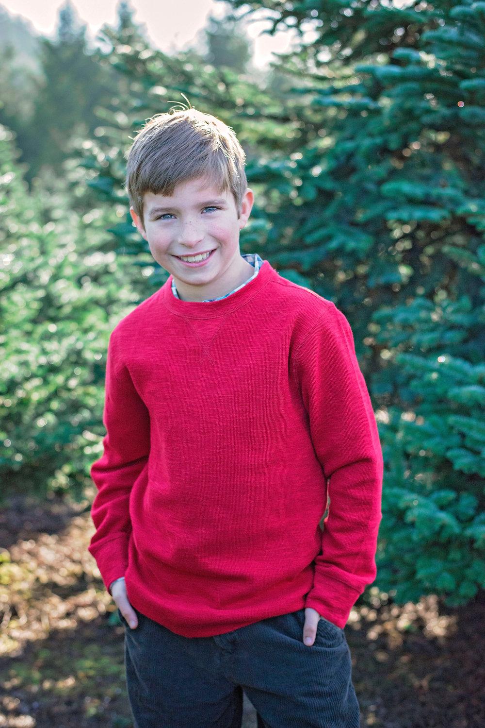 photo of a boy in a tree farm North Plains oregon.jpg