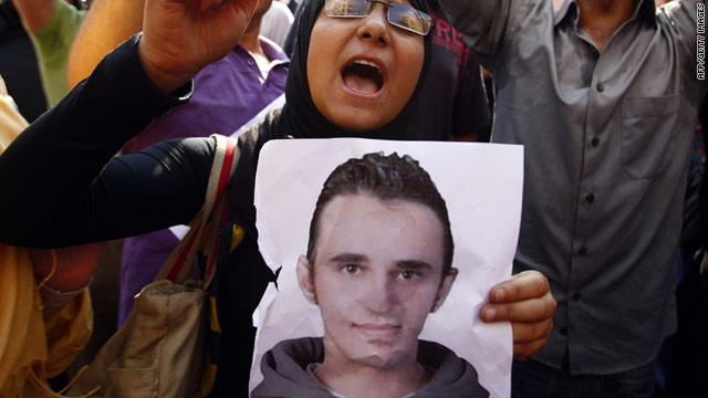 An Egyptian protestor carrying a poster of Khalid Said.