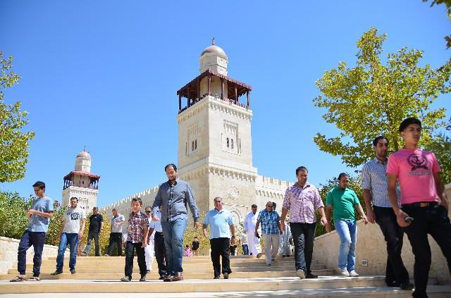 Jordanians coming out of a mosque after prayer [Jordan Times].