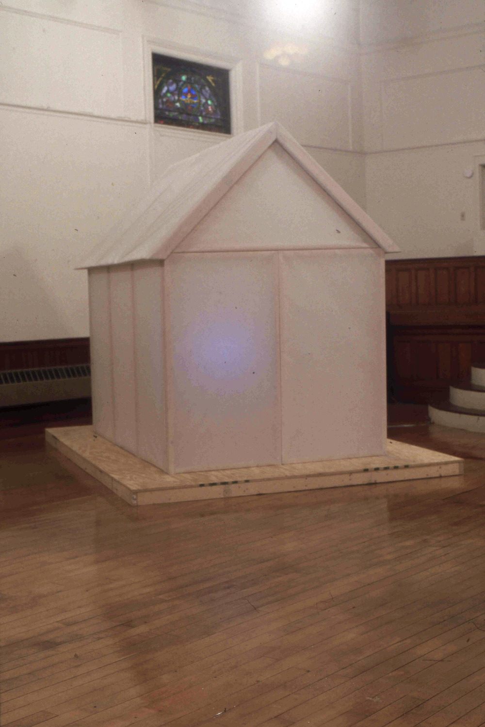 TV House, 2003, installation, wood and paper with TV off, 2003, 8' L x 6' W x 10' H