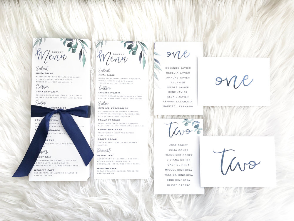 Day-of stationery: Watercolor greenery menus, escort cards, and table numbers.  Photography:  www.mlphotofilm.com