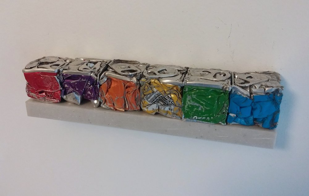Robert Hengeveld, Itten Judd Study, Rainbow, 2016, Crushed aluminum cans, Varied open edition, 6 x 1 x 1 inches.