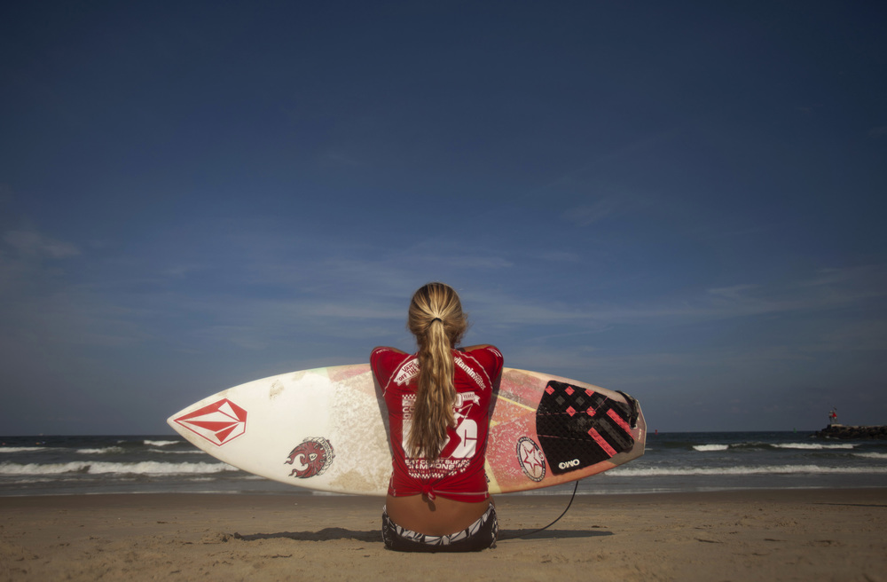 2012, Kayla Durden of Fl., waits on the beach for the start of her Viridian Women Pro Heat, at the East Coast Surfing Championships.