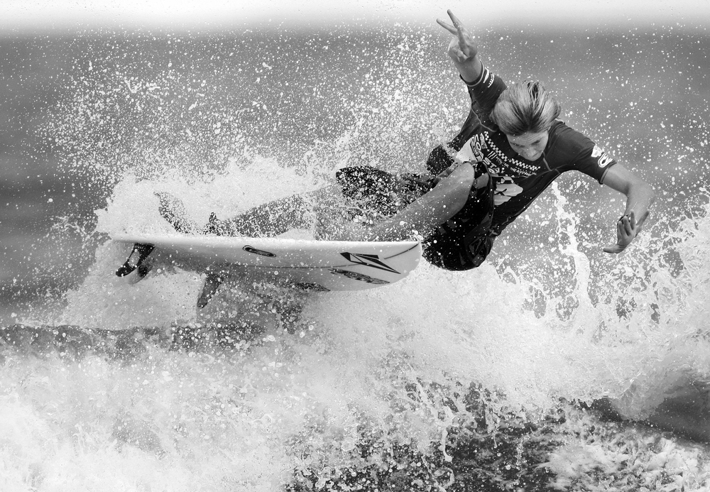 2010, Evan Barton tail slides his board as he cuts back on a wave during his heat in the Junior Division at the 48th Annual East Coast Surfing Championships.