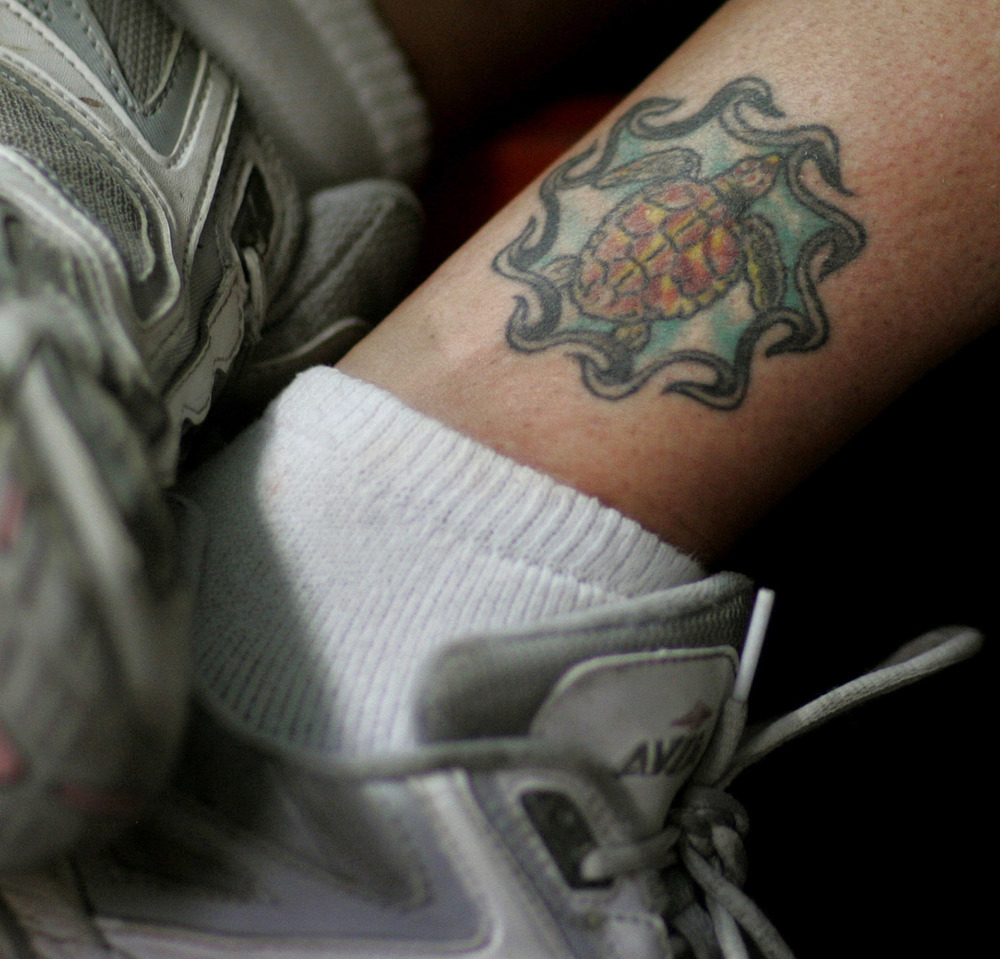 Tattoo of a loggerhead sea turtle on the leg of Christina Trapani, Assistant Stranding Response Coordinator of the Virginia Aquarium Stranding Response Program.