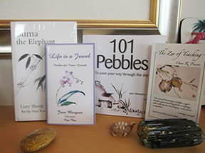 Books illustrated by Nan Rae: From left to right: Suma the Elephant by Gary Shoup, Life is a Jewel & 101 Pebbles by Joan Marques and The Zen of Teaching by Dane Pascoe.