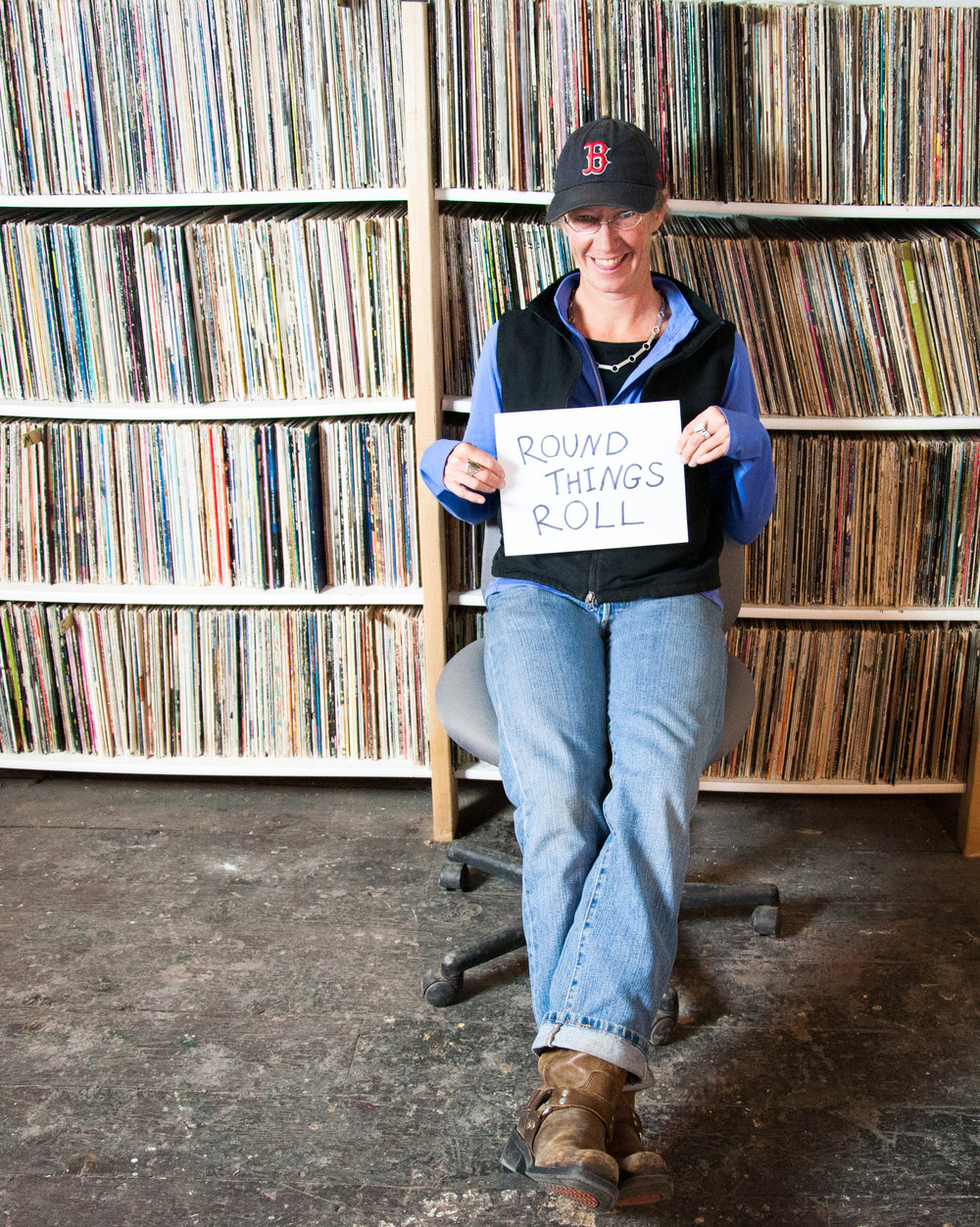DJ KT with the KMRD LP collection.  Photo by Caiti Lord
