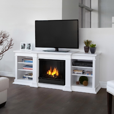 (6)  Double Duty  - Look, Ma! It's a TV Stand,  and  a fireplace! Via  Overstock.com