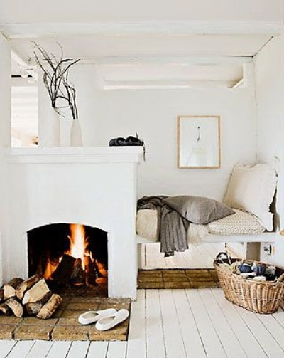 (10)  Sleep like a Log  - Use a D.I.Y. fireplace to divide your small space. Image via  A Simple Life Afloat .