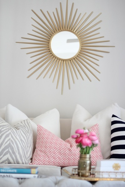 Get literal and literally bring the sun into your home with a sunburst mirror. Image via  DecorPad